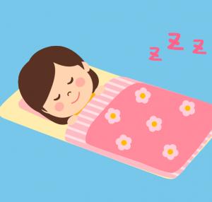【トップページ】布団で眠る女性